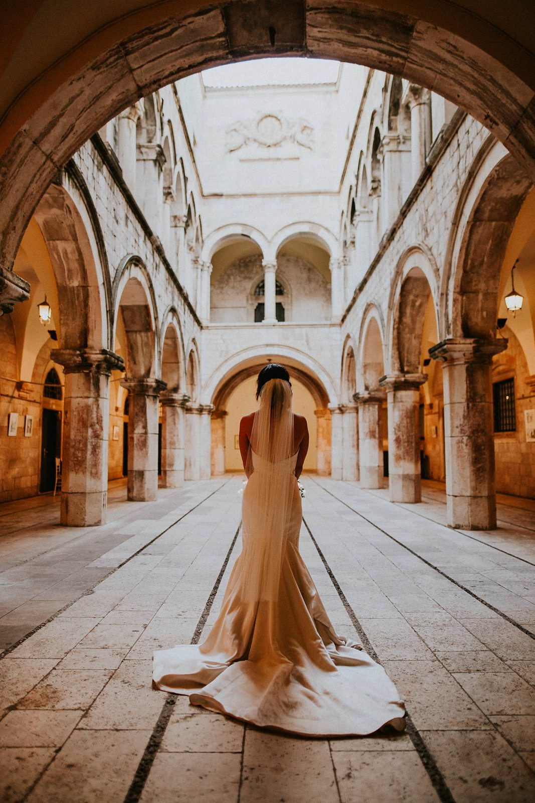 bride walking down the isle in Sponza Palace Dubrovnik