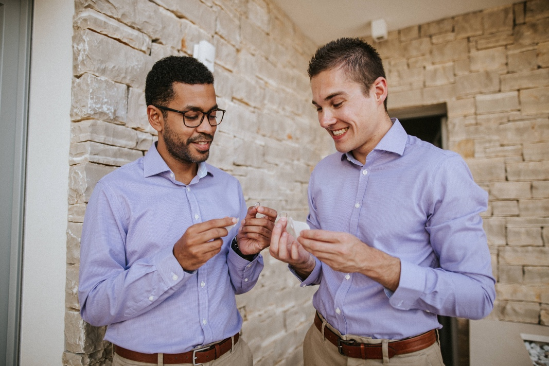 two best men preparing wedding rings