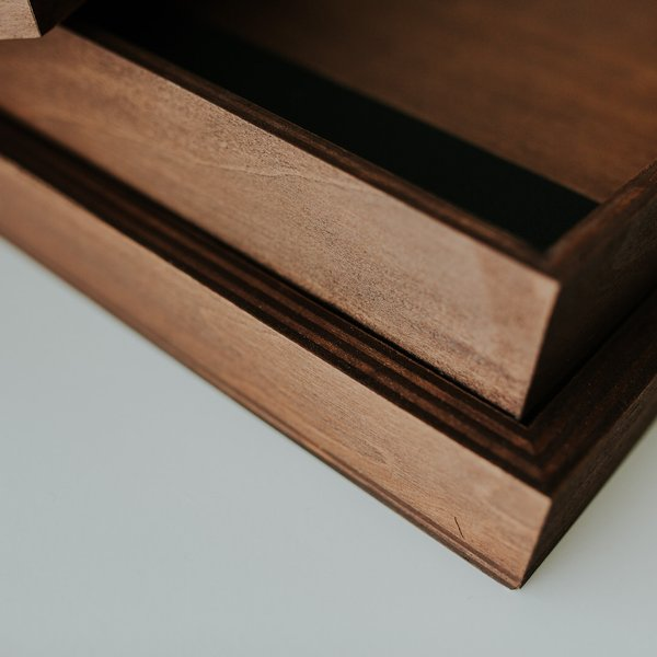Wood box was designed to compliment this book and will be made with the same color selected for the Book.
